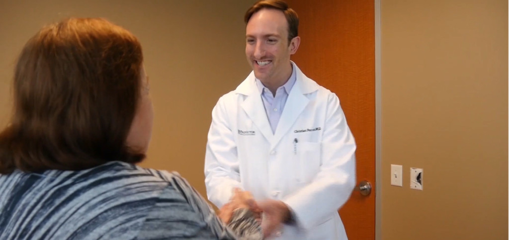 Christian Peccora, MD works with a patient in Sugar Land, Texas.