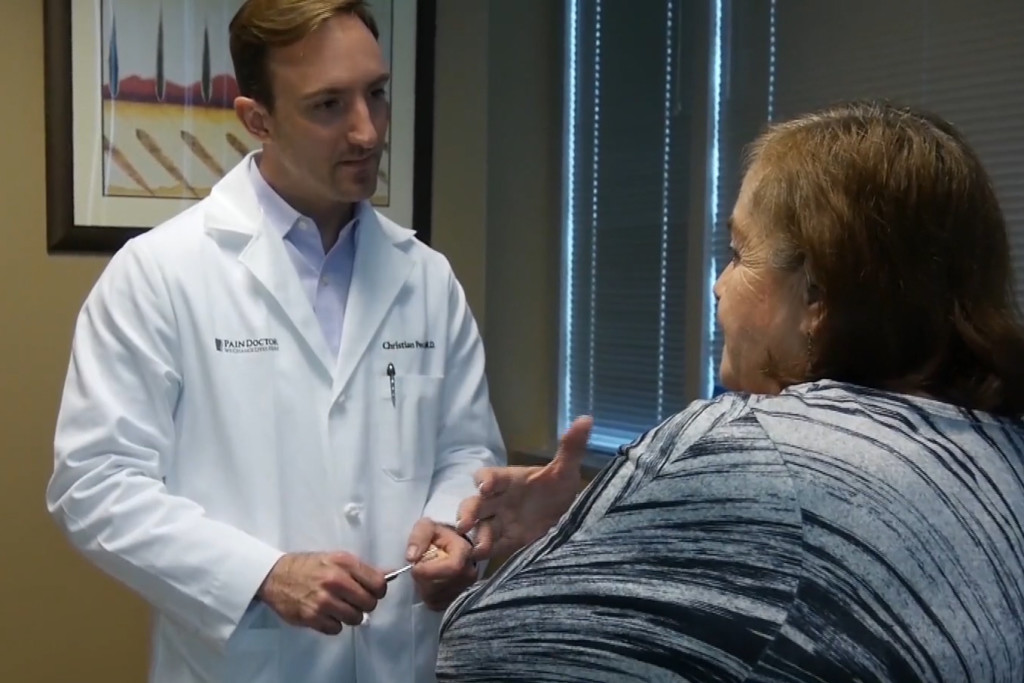 Dr. Christian Peccora works with a patient in Sugar Land.